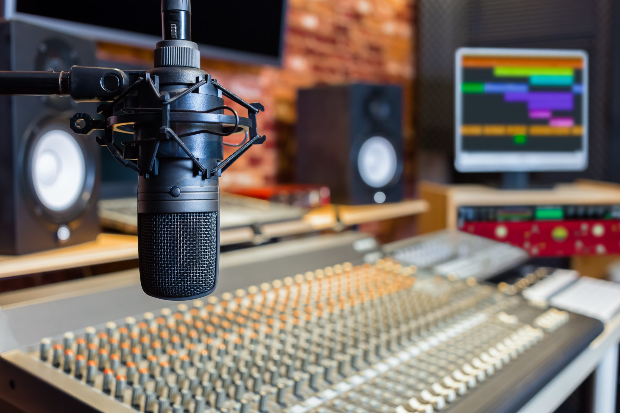 Microphone in studio with board and monitor